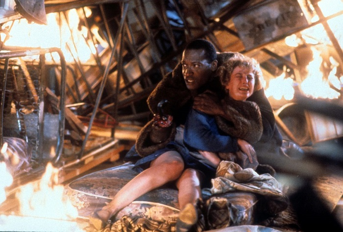Tony-Todd-holds-onto-Virginia-Madsen-in-a-scene-from-the-film-Candyman-1992-1200x811